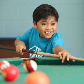 boy-playing-pool-bgcmia